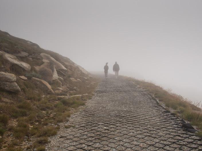 Two climbers descend towards Rawson Pass.